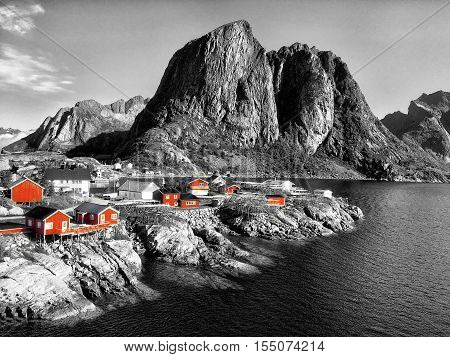 Traditional Norwegian fisherman's cabins rorbuer on the island of Hamnoy Reine on the Lofoten in northern Norway isolated on black and white background