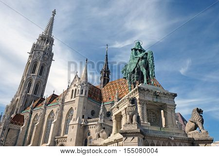BUDAPEST HUNGARY - SEPTEMBER 29 2016: Equestrian statue of the first king of Hungary Istvan Great and Matthias Cathedral in Buda castle
