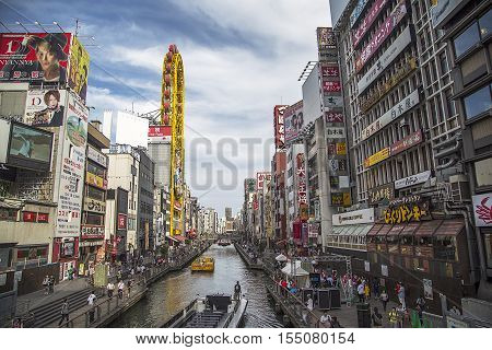 OSAKA, JAPAN - OCTOBER 9, 2016: Unidentified people on the street of Osaka Japan. Osakai is known for its modern architecture nightlife and hearty street food.
