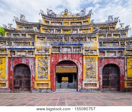 Colorful imperial city gate, Hue, Vietnam Impressive gate in the old citadel of Hue, the imperial forbidden purple city