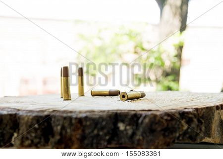 The bullets on the wooden background. Bullets for pneumatic.