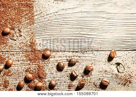 Coffe seed and wooden table as background