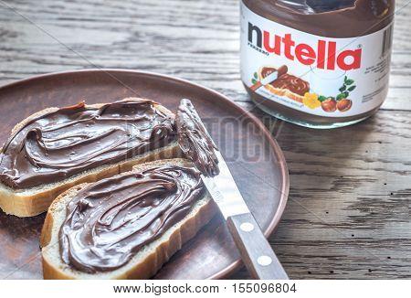 SUMY UKRAINE - NOV 3 2016: Nutella hazelnut spread jar. Nutella is a brand of sweetened hazelnut cocoa spread manufactured by the Italian company Ferrero.