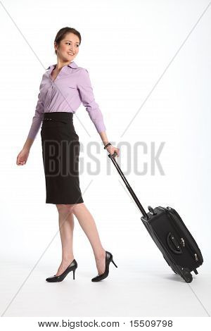 Career woman with travel suitcase