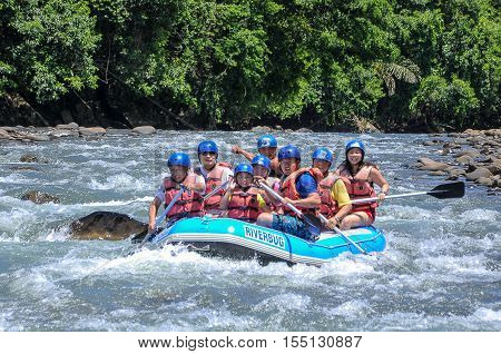 Kiulu,Sabah,Borneo-October 22,2011:Group of adventurer enjoying water rafting activity at Kiulu river Sabah,Borneo.The river graded level 1-2.Ideal for family outing & moderately adventurous.