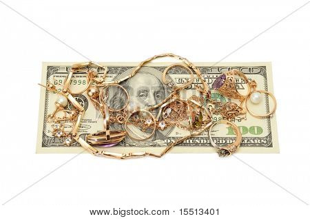 Gold ornaments and dollars isolated on a white background