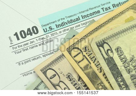 closeup of us tax form and us money