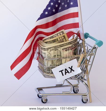 American dollars and flag in a trolley for taxation payments.