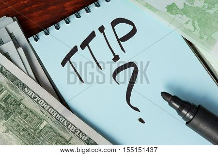 TTIP written in a note. Transatlantic Trade and Investment Partnership concept.