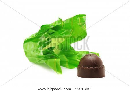 Chocolates and candy wrapper isolated on a white background