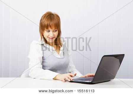 Girl With Surprise Stares At The Monitor Laptop