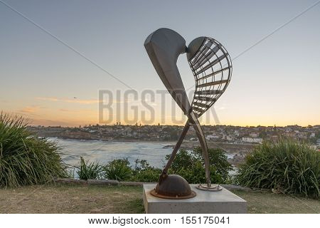5th of November 2016 Bondi Beach Sydney Australia. Geoffrey Bartlett Embrace sculpture against the sunset at Sculpture by the Sea. Free annual event