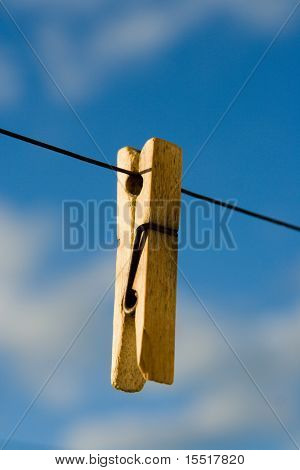Wooden clothespin on a wire