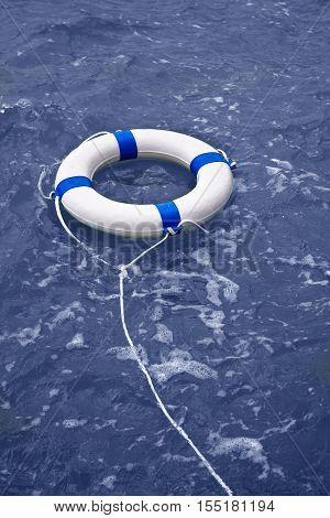 Buoy lifebelt lifesaver floating in blue ocean as help equipment