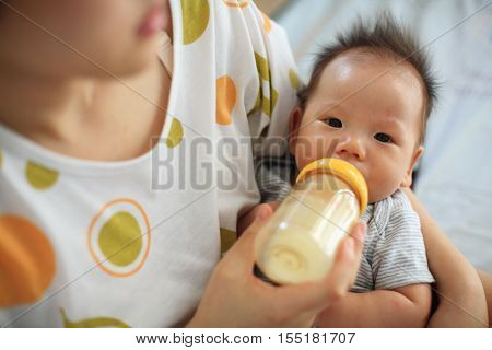 Mother Feeds  Breastmik By Bottle