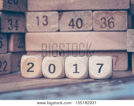 Number 2017 with new year on Toy number blocks /Color filter and Selective focus