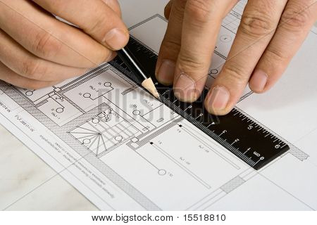 The engineering drawing on a paper. Ruler. Pencil.
