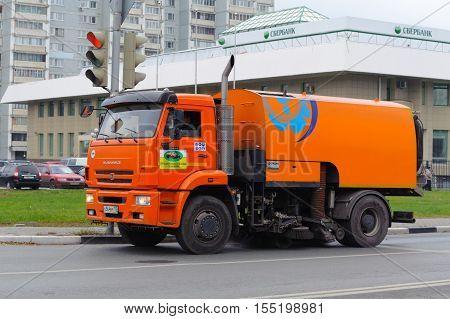 BALASHIKHA RUSSIA - OCTOBER 28: Cleaning orange car driving on Sverdlov Street on October 28 2016 in Balashikha. Balashikha is city in Moscow Oblast Russia located on Pekhorka River 1 kilometer east of Moscow.