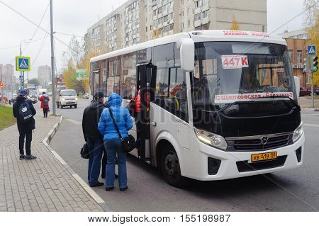 BALASHIKHA RUSSIA - OCTOBER 28: Passengers entering the bus on Sverdlov Street on October 28 2016 in Balashikha. Balashikha is city in Moscow Oblast Russia located on Pekhorka River 1 kilometer east of Moscow.