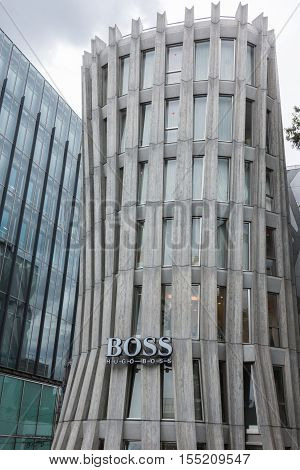 Tokyo Japan - September 28 2016: The iconic Hugo Boss store stands along the main road in the upscale neighborhood of Jingumae. Concrete and glass.