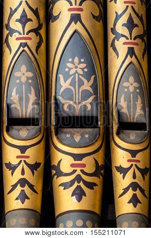 Elaborately decorated organ pipes in a church