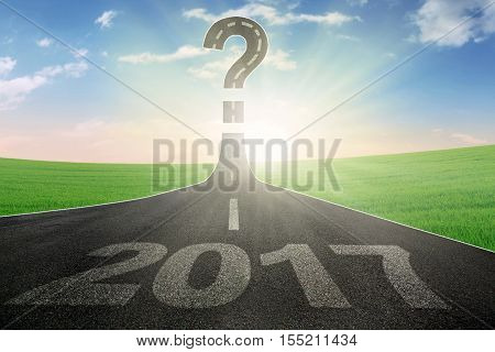 Image of empty road with number 2017 and question mark. Concept of uncertainty new year 2017