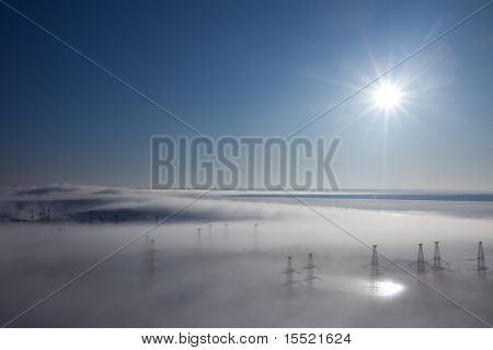 Winter landscape. fog over earth. top view