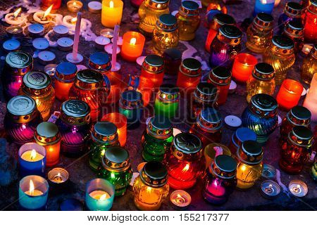 Uzhgorod Ukraine - November 1 2016: Lanterns on the grave in old cemetery. On this day the locals decorate the graves with flowers and burning candles of memory.