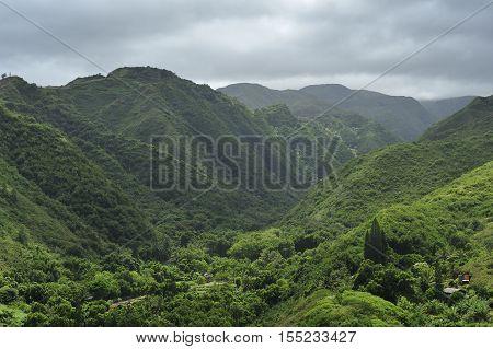 Green tropical valley and dramatic sky, Maui, Hawaii