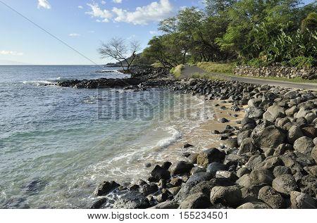 Rocky beach near a scenic road on Maui coastline, Hawaii