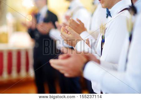 Groomsmen During Catholic Wedding Ceremony
