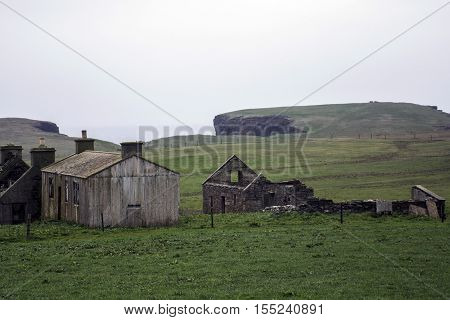Old left house at Orkney coastline Yesnaby cliff landscape