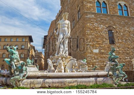 Fountain of Neptune surrounded by medieval buildings in Piazza della Signoria Florence region of Tuscany Italy