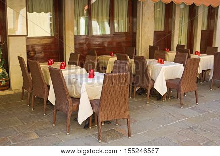 Typical italian outdoor places of the cafe neatly served