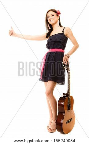 Travel vacation hitchhiking concept. Summer girl hippie style in full length with acoustic guitar thumbing and hitch hiking isolated on white