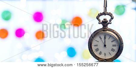 Old Clock Close To Midnight And Sparkling Christmas Decoration - New Year Concept