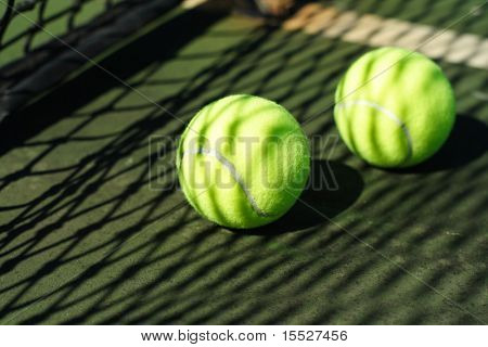 Two tennis balls in a court