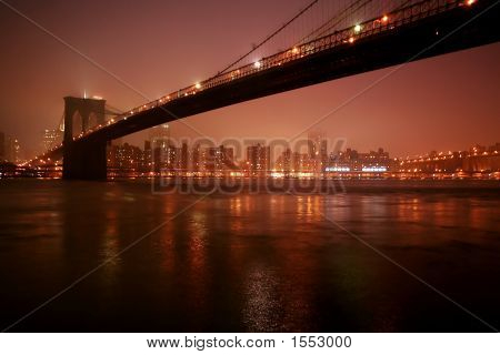 Brooklyn Bridge Stretching Over The East River
