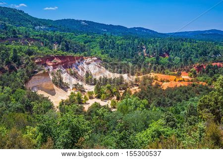 Languedoc - Roussillon, France. The pit on production ochre. Orange picturesque hills