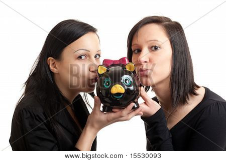 Two Young Women Piggy Bank Kissing