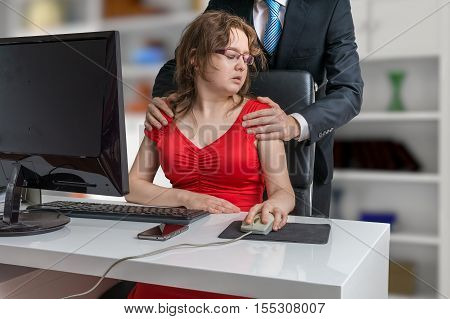 Boss or manager is touching secretary. Sexual harassment in office.