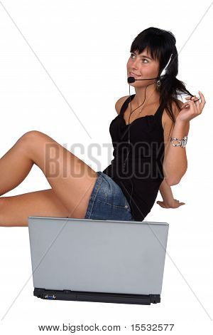 Girl with laptop and headset