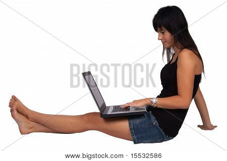 Woman sitting on the floor with laptop