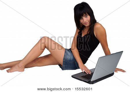 Woman with laptop sitting on the floor
