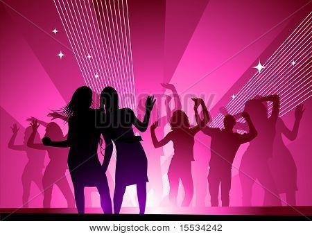 Girls out dancing in a nightclub having fun.