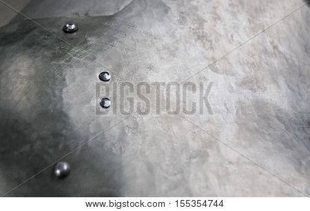 Metal background, sheet of metal surface with rivet heading,  texture of titanium, gray metal
