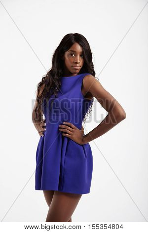 black woman with long wavy hair in studio