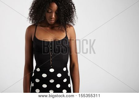 Black Woman With Curly Hair Watching Down