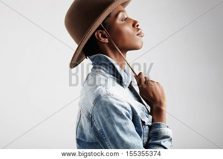 Black Womans Profile Wears Jeans Jacket And Hat