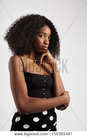 one pretty black woman with curly hair